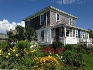 Classic year-round island home with exceptional gardens. In the
